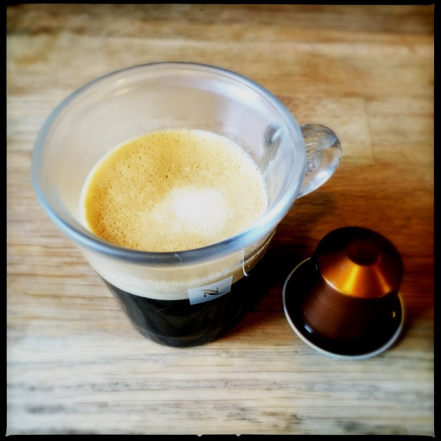 Nespresso's Livanto coffee capsule with espresso cup.