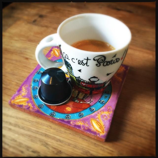 Nespresso's Kazaar capsule and espresso cup.