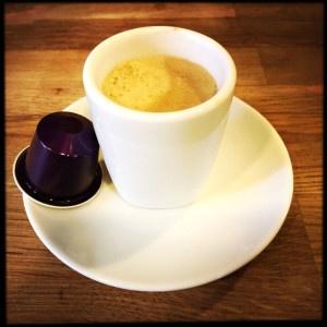 Nespresso's Arpeggio capsule and coffee cup