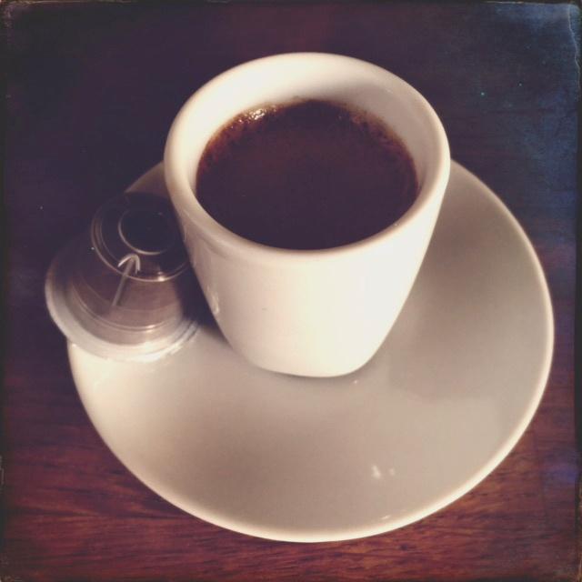 Gourmesso's Bolivia Pura Mezzo capsule and coffee cup