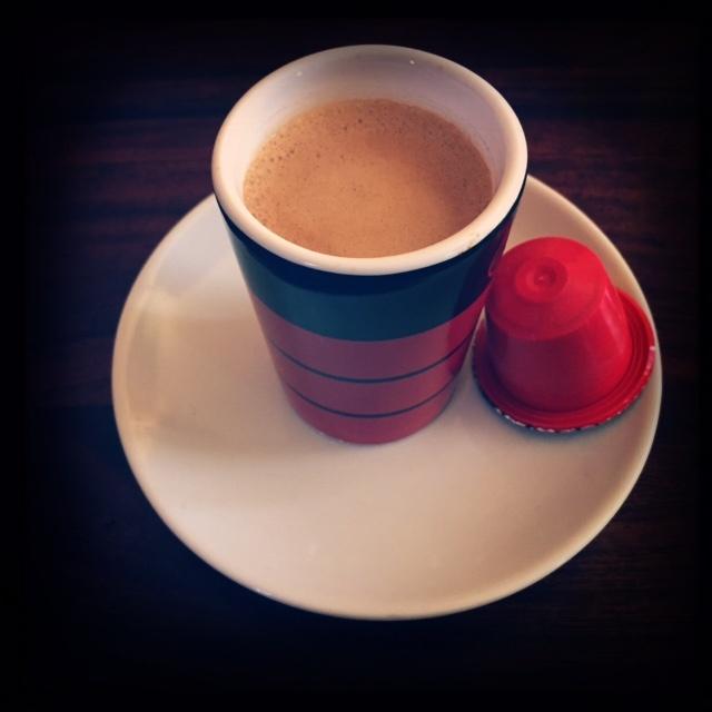 Rosso Caffe's Decaffeinato capsule and coffee cup
