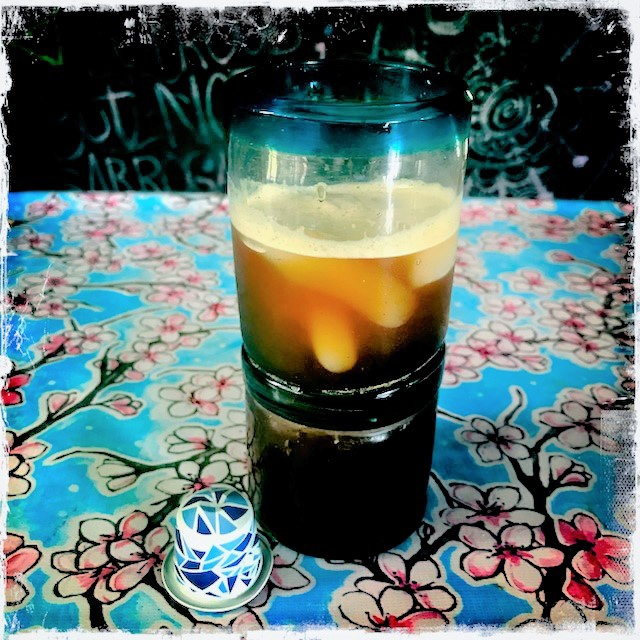 Nespresso's Intenso On Ice capsule and drink